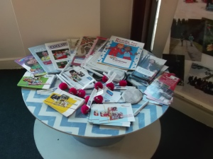 Table covered in Girlguiding leaflets and freebies