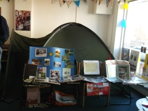 A dome tent and display boards in a shop space
