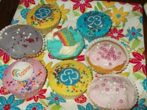 Fairy cakes decorated with trefoils and rainbow sweets